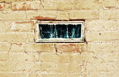 Old window in an old wall-grunge background Stock Images