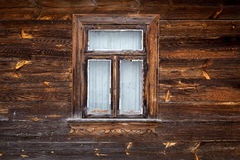 The old window of old wooden house. Background of wooden walls. Old window of old wooden house. Background of wooden walls stock photography