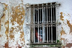 Old Window. An opening in the wall or roof of a building or vehicle that is fitted with glass or other transparent material in a frame to admit light or air Stock Photography