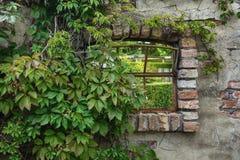 Old window overlooking the garden. Stock Image