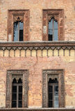 Old window in palace on Piazza Sordello The historic city center of Mantova Lombardy Royalty Free Stock Photo