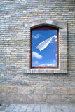 Old Window and paper plane Royalty Free Stock Images