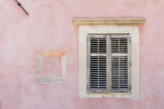 Old window and pink wall Royalty Free Stock Photography