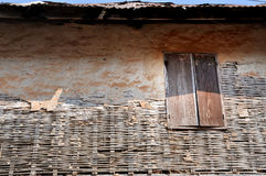 Old window. With plaster and brick wall fallen in chiangkhan Loie Thailand Stock Photo
