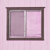 Old window with plastic window blinds with wood walls. Royalty Free Stock Photo