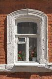 Old window with red brick wall Royalty Free Stock Image