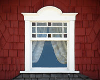 Old window on red wall Stock Photography