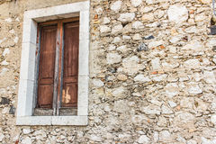 Old window and rocky wall Royalty Free Stock Photo
