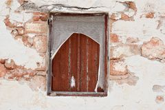 Old Window in Ruin. Wooden brown frames. Abandoned house. Brick wall. Pefkos, Rhodes, Greece Royalty Free Stock Images