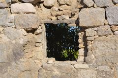 Old window of ruined home in Kefalos Stock Images