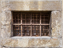 Old window with rusty bars Stock Image