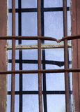 Old window with a rusty grate Stock Images