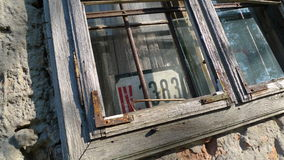 Old window sash. Old window with wooden sash and number Royalty Free Stock Images