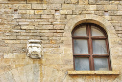 Old window and sculpture Royalty Free Stock Photos