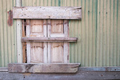Old window, sealed with wooden planks. stock image