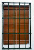Old window with security bars, steel grill Royalty Free Stock Images