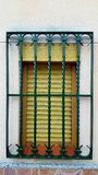 Old window with security bars, steel grill Stock Photography
