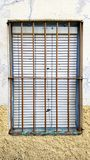 Old window with security bars, steel grill Royalty Free Stock Photo