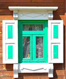 Old window shutters. Are painted with green paint. Architecture in style of retros Stock Photo