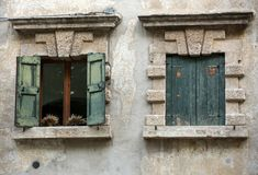 Old window shutters in ancient stone wall. Verona,. Italy Stock Photo