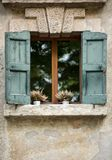 Old window shutters in ancient stone wall. Verona,. Italy Stock Image
