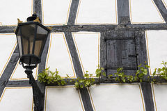 Old window with shutters, antique lantern and grapevine, Germany Royalty Free Stock Photography