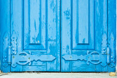 Old window shutters. Old blue window shutters with decorative hinges Royalty Free Stock Photos