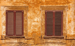 Old window with shutters damaged Stock Image