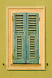 Old window shutters on the light green wall Royalty Free Stock Photo