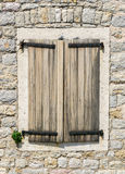 Old Window with Shutters in Montenegro. Old window with wooden shutters in a medieval stone house in the town of Budva, Montenegro Royalty Free Stock Photos