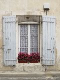 Old window with shutters in Provence style. White curtains royalty free stock photo