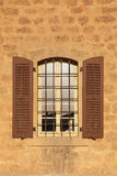 Old window with shutters in stone wall, Jaffa, Tel Aviv, Israel Royalty Free Stock Images