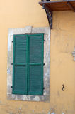 Old window shutters. Very old style building with closed window shutters in Cyprus Stock Images