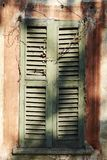 Old window with shutters in wood, ruined by time Stock Photo