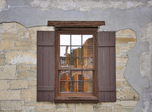 Old window with shutters. Old window with wooden shutters Stock Photo