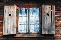 Old window shutters in  wooden wall Royalty Free Stock Images