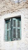 Old Shutters. Old window shutters on a yellow building royalty free stock image