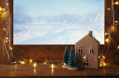 Old window sill with gold christmas lights. In front of dreamy and magical winter snow landscape background stock images
