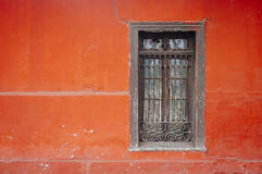 Old window. Small wooden window antua in red wall Stock Images