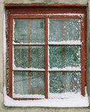 Old window in the snow Stock Photo