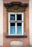 Old window with stone decoration Royalty Free Stock Photos