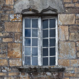 Old window in a stone house Royalty Free Stock Photo