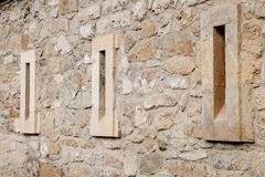 Old window in stone wall castle royalty free stock photography