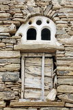 Old window in a stone wall Stock Images