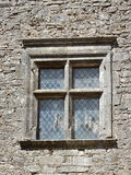 Old window in stone work wall leaded glass Stock Photography