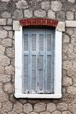 Old window on textured wall on greece royalty free stock image