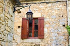 Old window in the village of Castelnaud Stock Photos