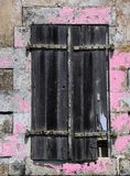 Old window with weathered wood shutters Stock Image