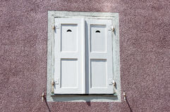 Old window with white closed shutters Stock Photography