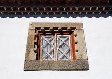 Old window in white rural house, Portugal. Royalty Free Stock Photos